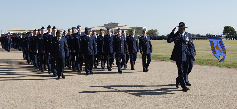 A flight of Airman marching across the bombrun at an Air force Basic Military Training graduation